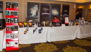 Penny Grubb manages the book stall before the crowds descend.